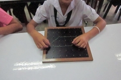 Student_with_geoboard_1_Q2